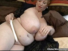 Fat granny Dagny in the matter of her big tits plays in the matter of vibrator